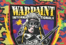 Warpaint International Silkscreen on the back of a Renegade Glow oak pullover.