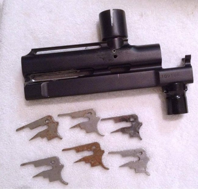 An unknown Autococker body and some pre 98 trigger plates.