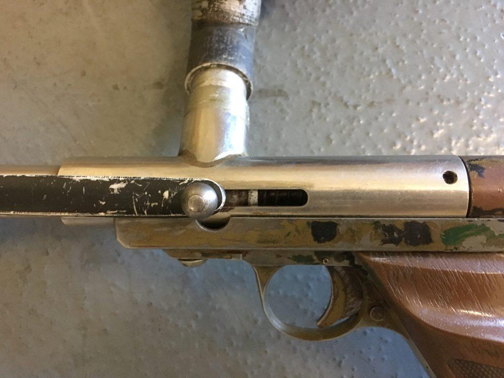 Stainless Body Nelson based pistol close up. Left side braised feedneck.