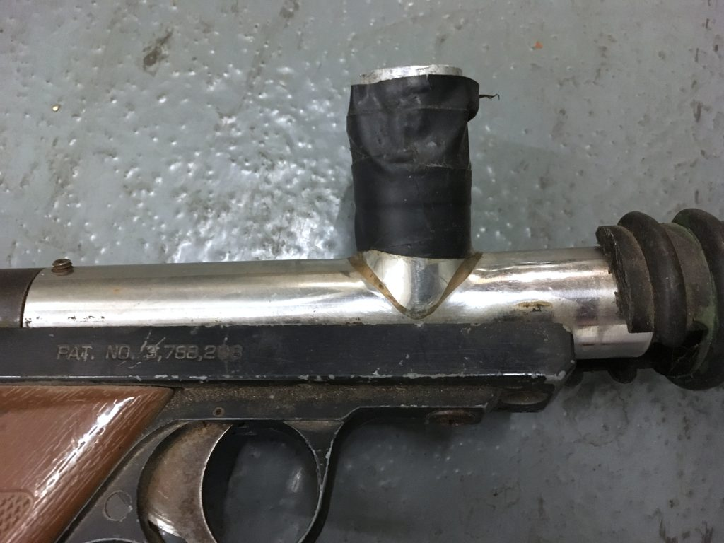 Close up of right side feedneck on stainless long barrel Nelspot.