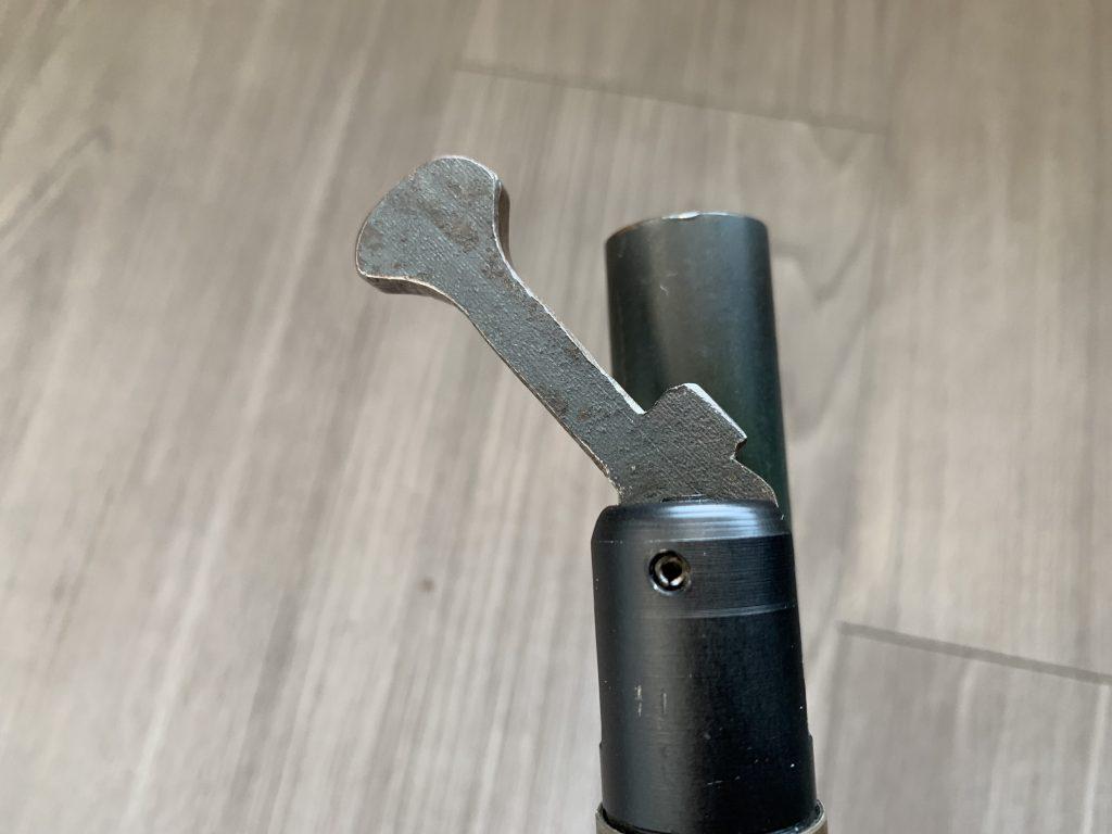 A close of up Dennis' Martinez' Dog Bone 12 gram lever changer.