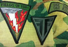 A field of Fire and field of fury patch on an old BDU.